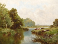 Cattle Grazing by a Riverbank